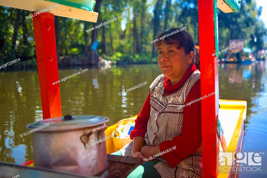 Stock Photo: Mature woman traveling on a trajineras, Xochimilco, Mexico.