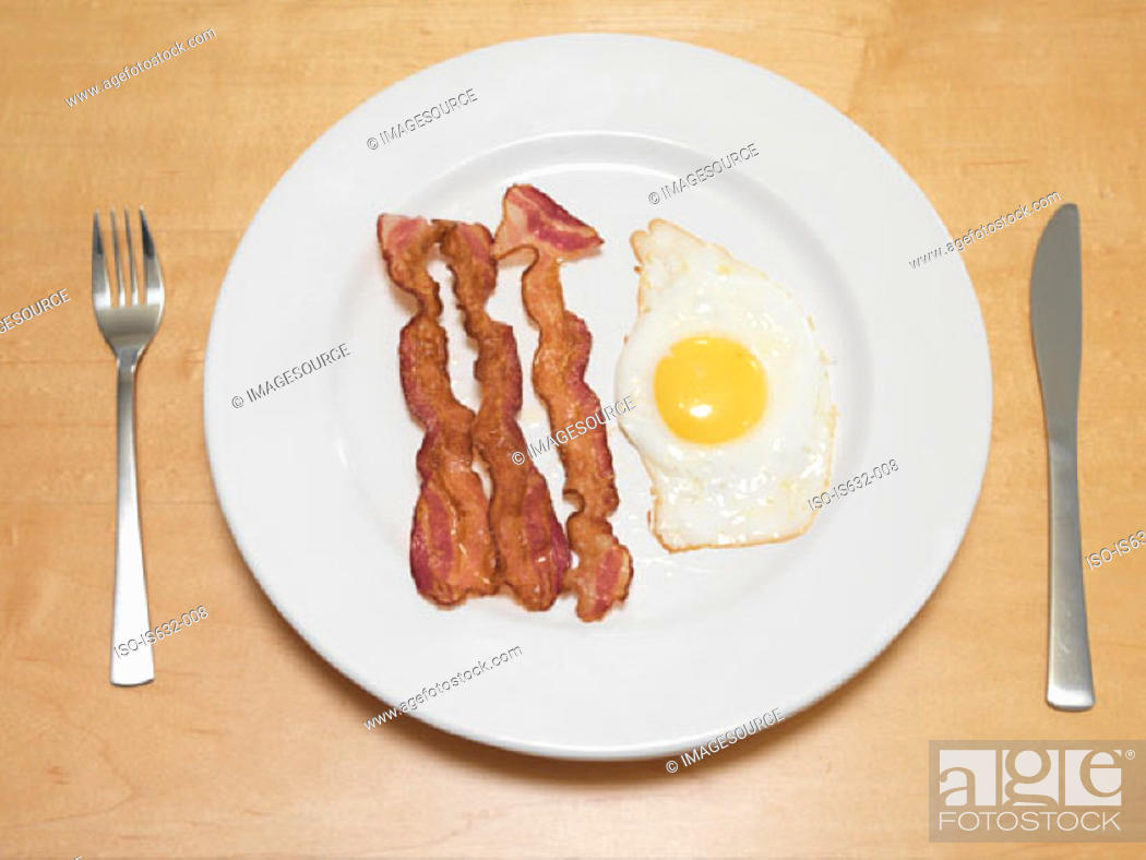 Stock Photo: Fried egg and bacon.