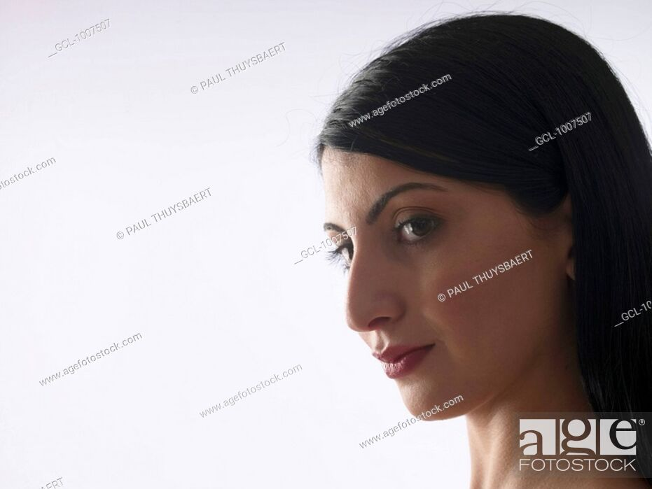Stock Photo: Close-Up of a thoughtful woman.