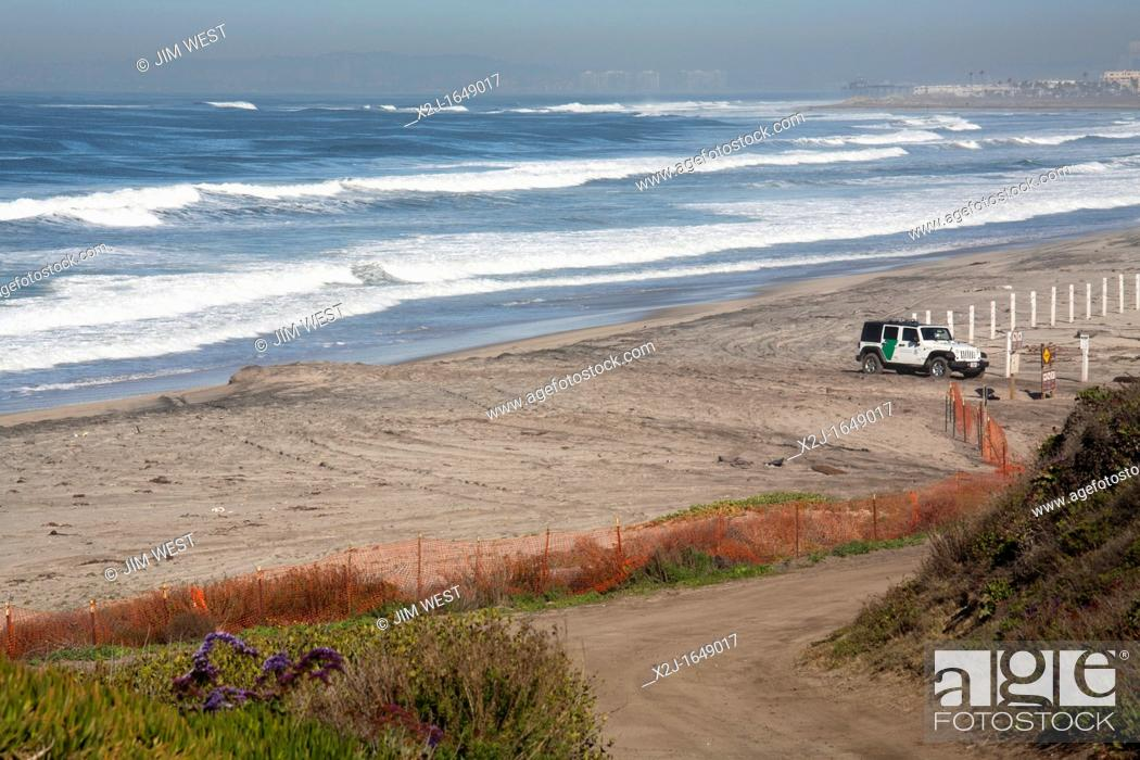 Stock Photo San Ysidro California A U S Border Patrol Jeep Guards The Beach At