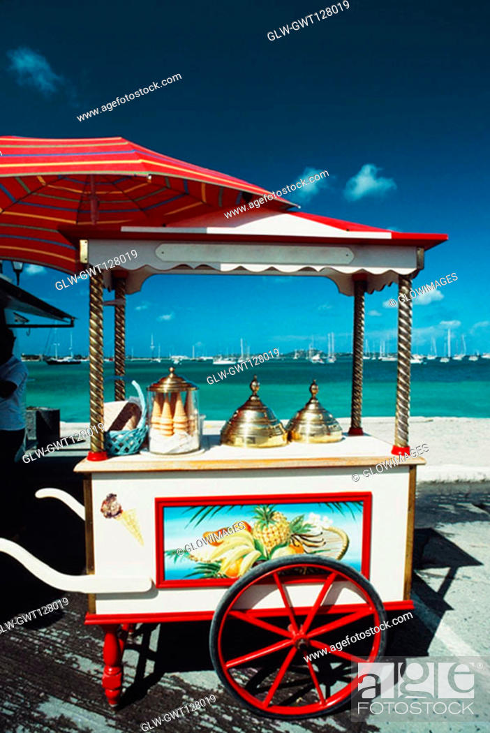 Stock Photo: Side view of a cart with a brass lid and ice-cream cone placed on it, St. Martin.