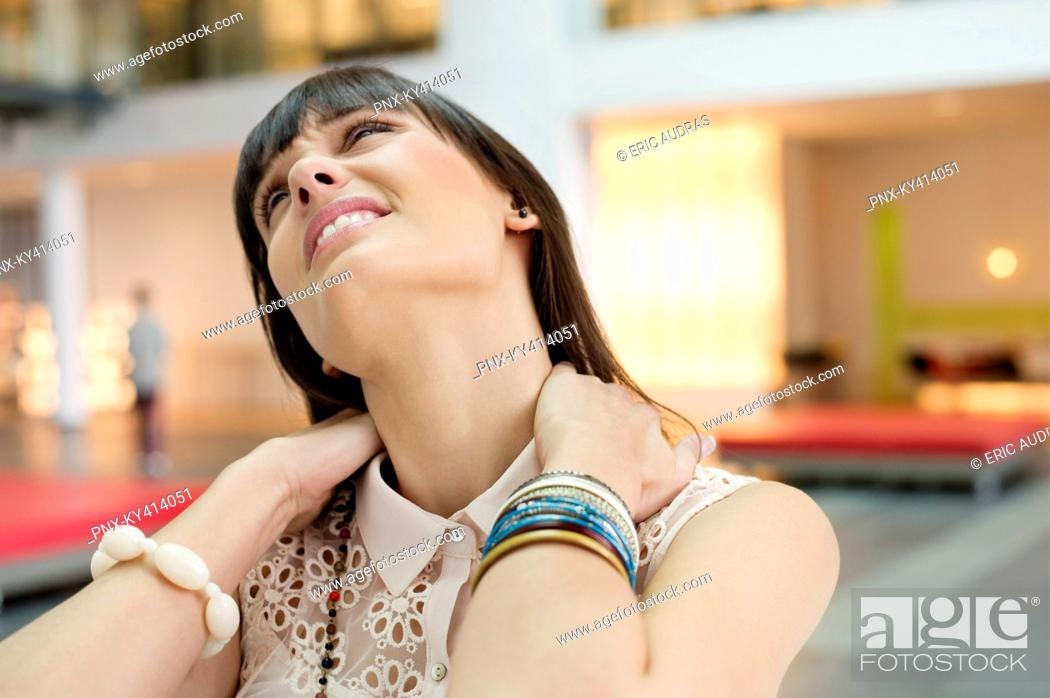 Stock Photo: Close-up of a businesswoman suffering from neckache.