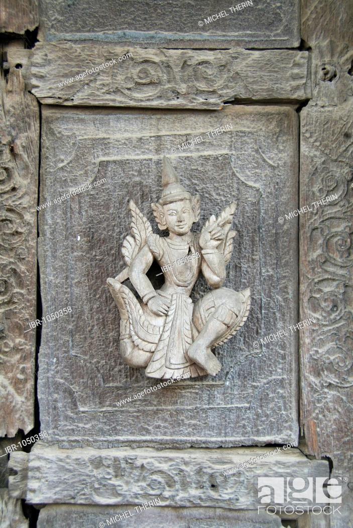 Stock Photo: Carved figure on a teak door, Monastery Shwe In Bin Kyaung, Mandalay, Burma, Myanmar, Southeast Asia.