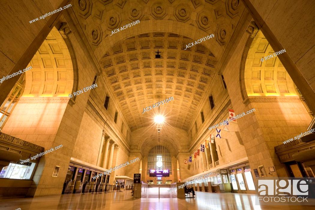 Stock Photo: The Grand Hall in Toronto Union Station in downtown Toronto, Ontario, Canada has a coffered vault ceiling of Gustavino tiles and a marble herringbone patterned.