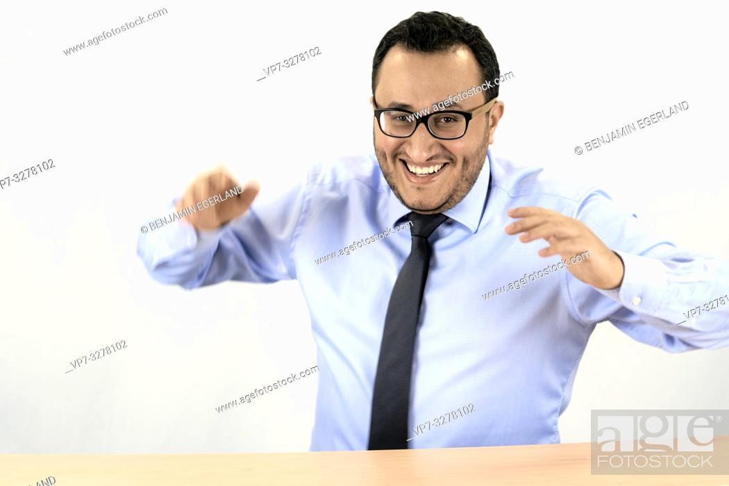 Imagen: buoyant business man, happy elated, in Cottbus, Brandenburg, Germany.