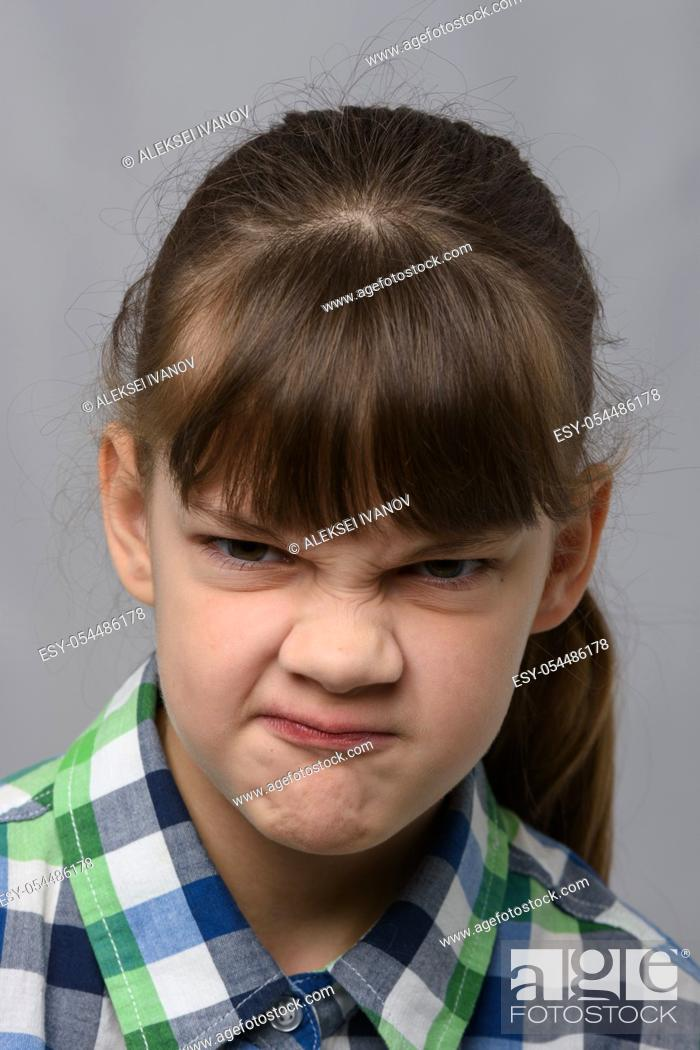 Stock Photo: Portrait of a vile ten-year-old girl of European appearance, close-up.