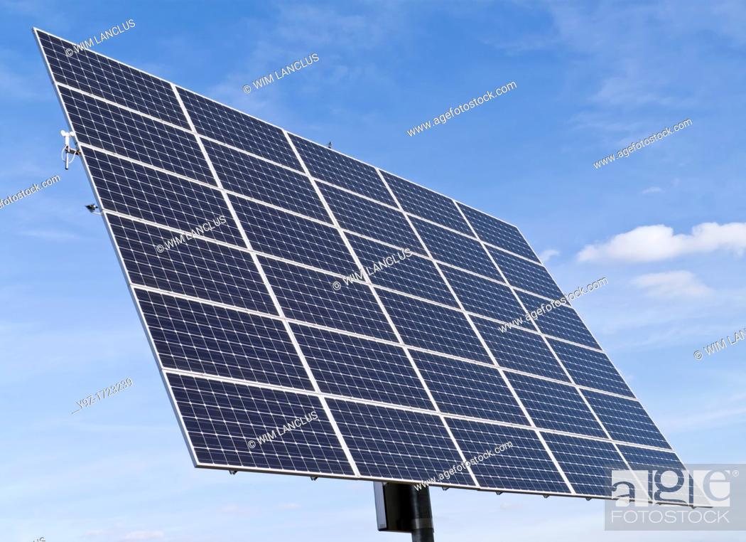 Stock Photo: Solar panels against clear blue sky.