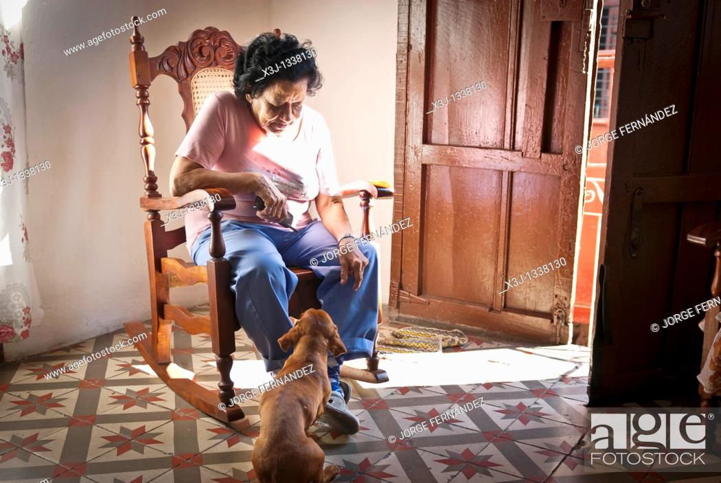 Terrific Woman On A Rocking Chair With Her Dog Santiago De Cuba Squirreltailoven Fun Painted Chair Ideas Images Squirreltailovenorg