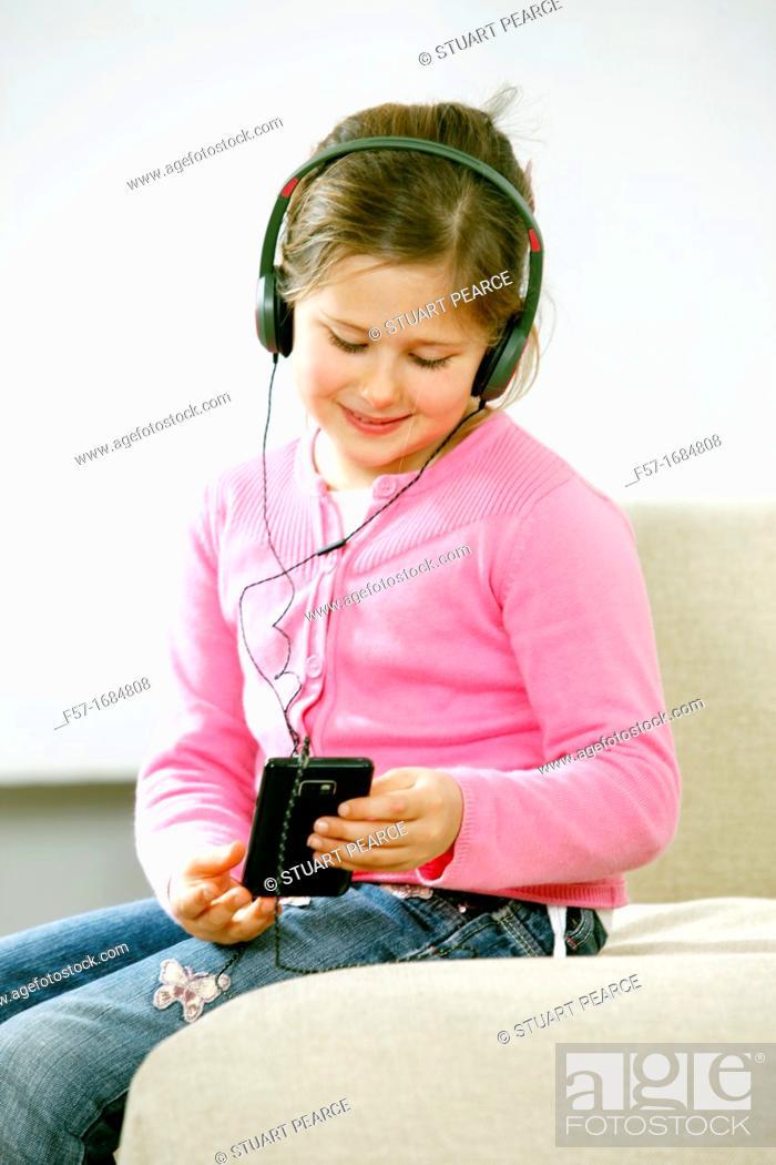 Stock Photo: Girl using smartphone.