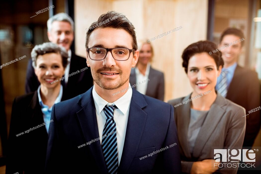Stock Photo: Business team smiling at the camera.