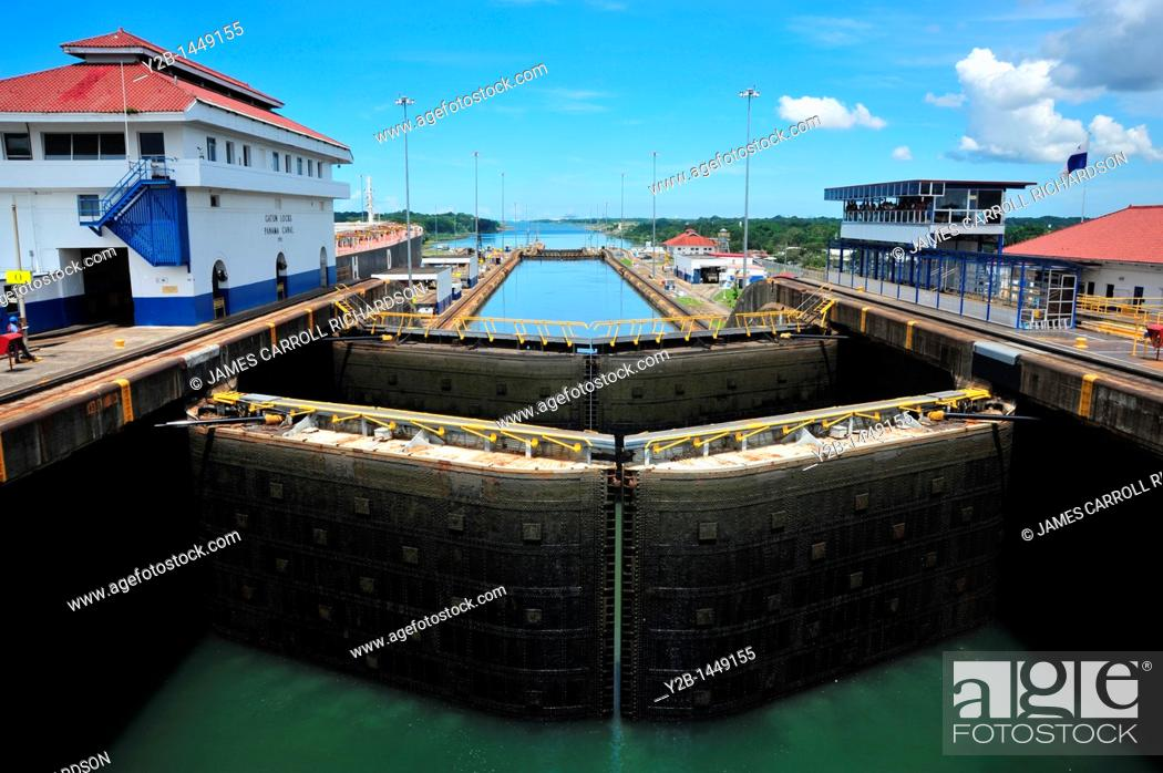 Stock Photo: Panama Canal locks filling with water for passage of ship, Panama.
