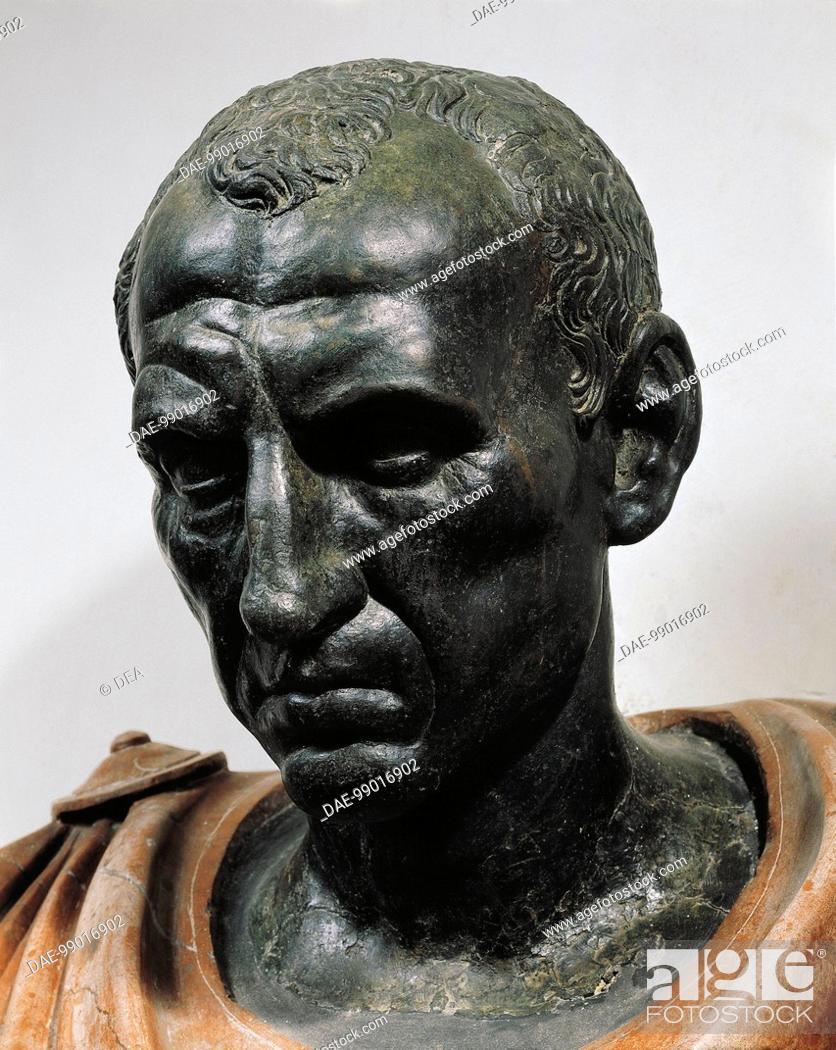 Stock Photo: Roman civilization, 1st century b.C. Bronze head with marble bust of Julius Caesar, 100-44 b.C. Detail, face.  Roma, Museo Nazionale Romano Palazzo Altemps.