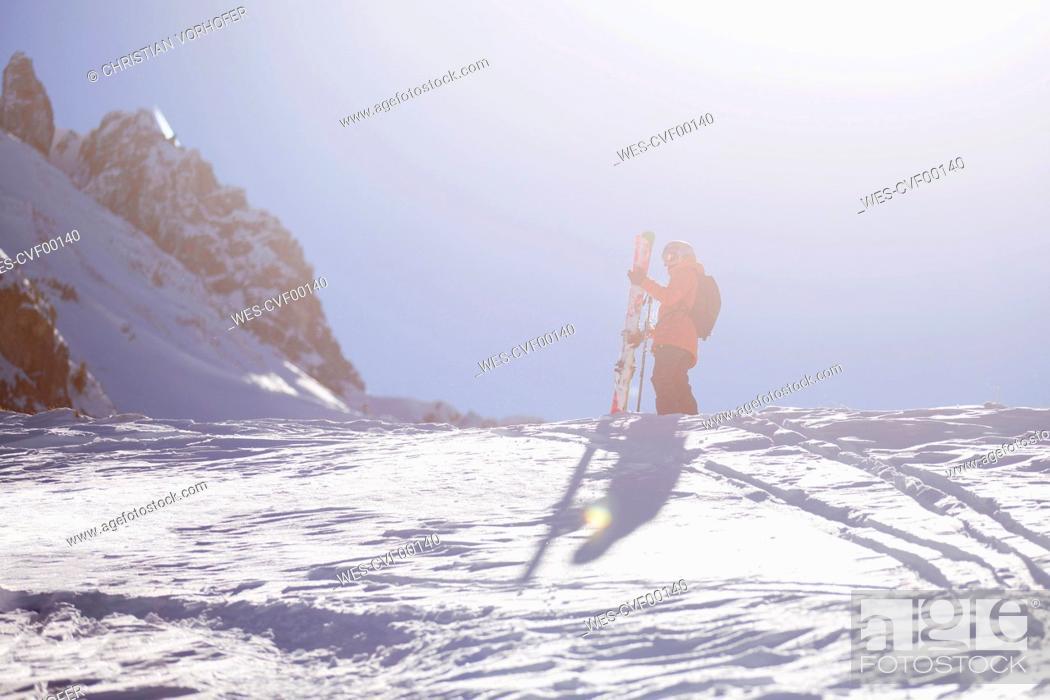 Stock Photo: Austria, Tyrol, Mutters, freeride skier ascending mountain.