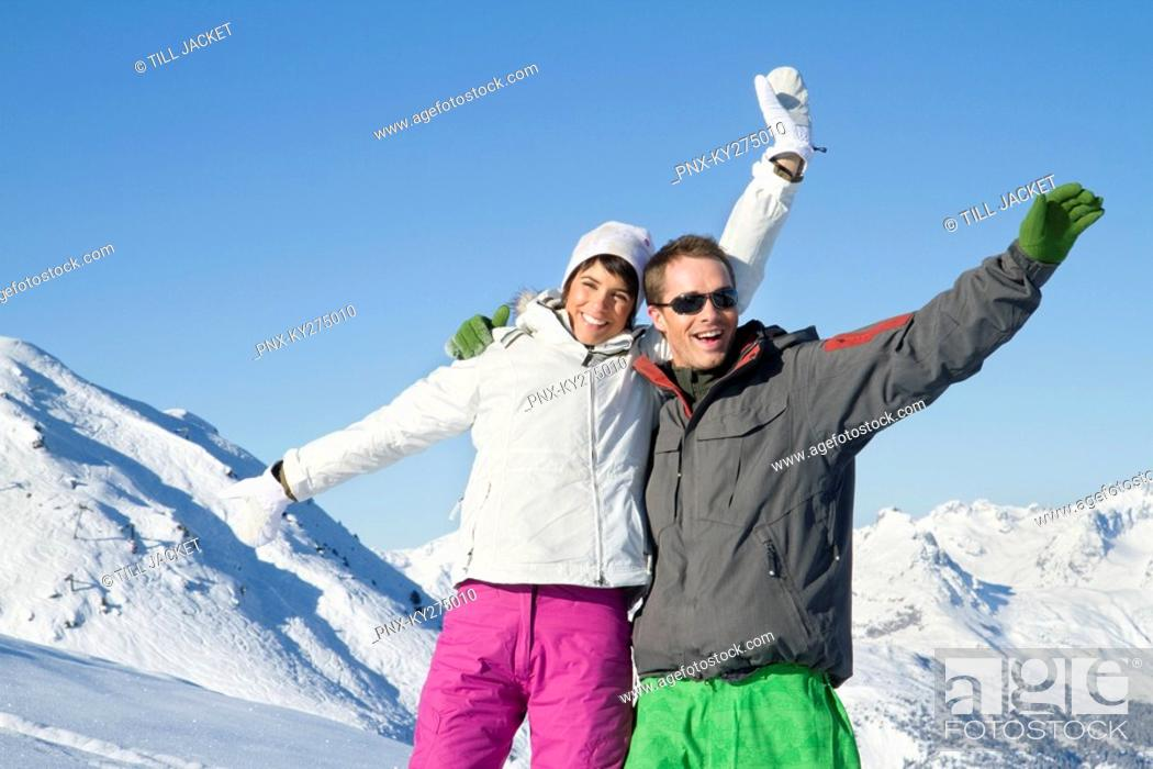 Stock Photo: Young couple in ski wear, smiling at camera.