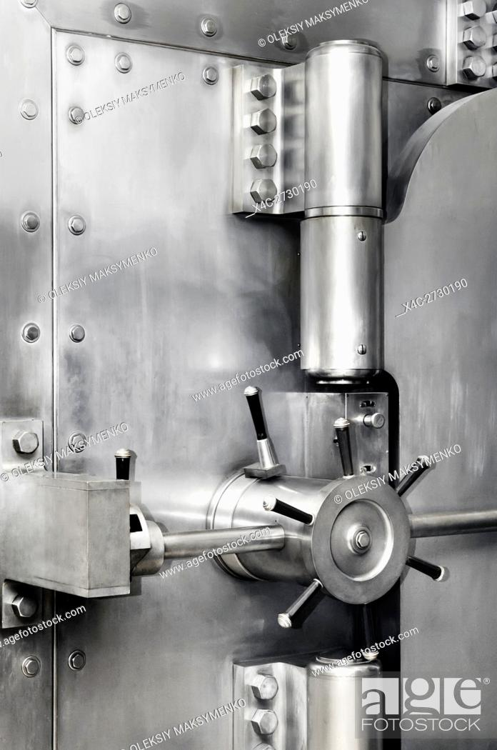 Photo de stock: Bank vault stainless steel safe door lock and hinges. Banking, safety deposit, security concept.