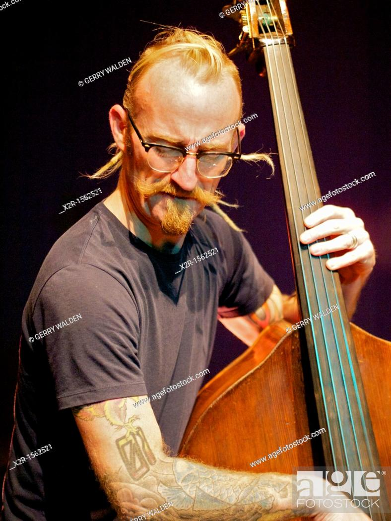 Rex Horan playing bass during the sound check for his performance