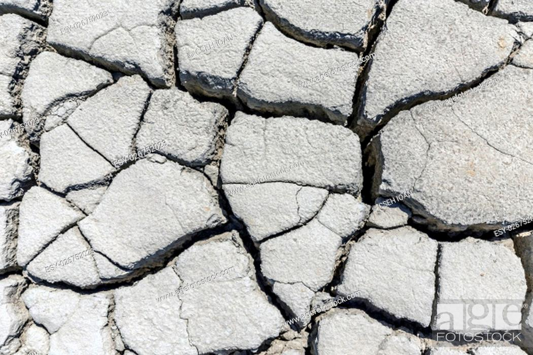 Stock Photo: Soil drought cracked texture and background.