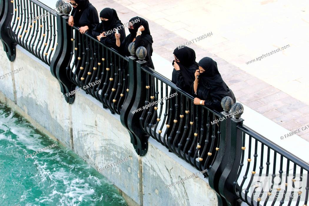 Stock Photo: Qatar - Doha - The Pearl - Porto Arabia - Qatari women looking at jet ski on La Croisette.