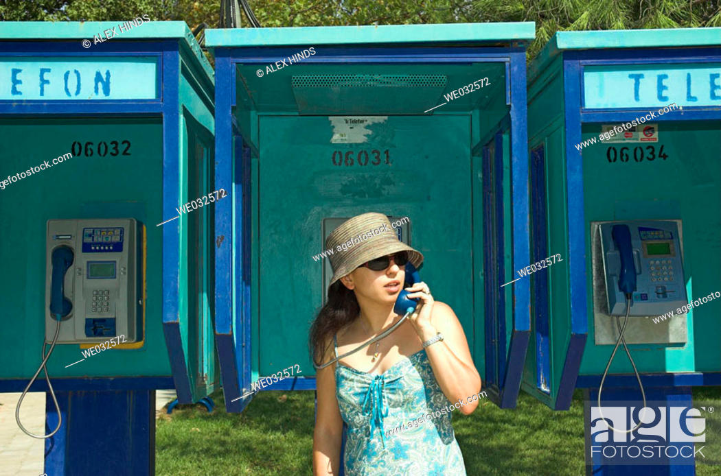 Stock Photo: Young woman on public pay phone. Fethiye, Turkey.