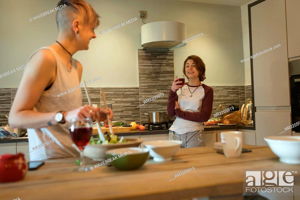 Free lesbians makes out while making spaghetti Lesbian Couple Preparing Food And Having Wine In Kitchen Stock Photo Picture And Royalty Free Image Pic Wr3205919 Agefotostock