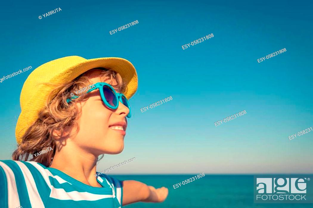 Stock Photo: Happy child on the beach. Kid having fun on summer vacation. Healthy active lifestyle concept.