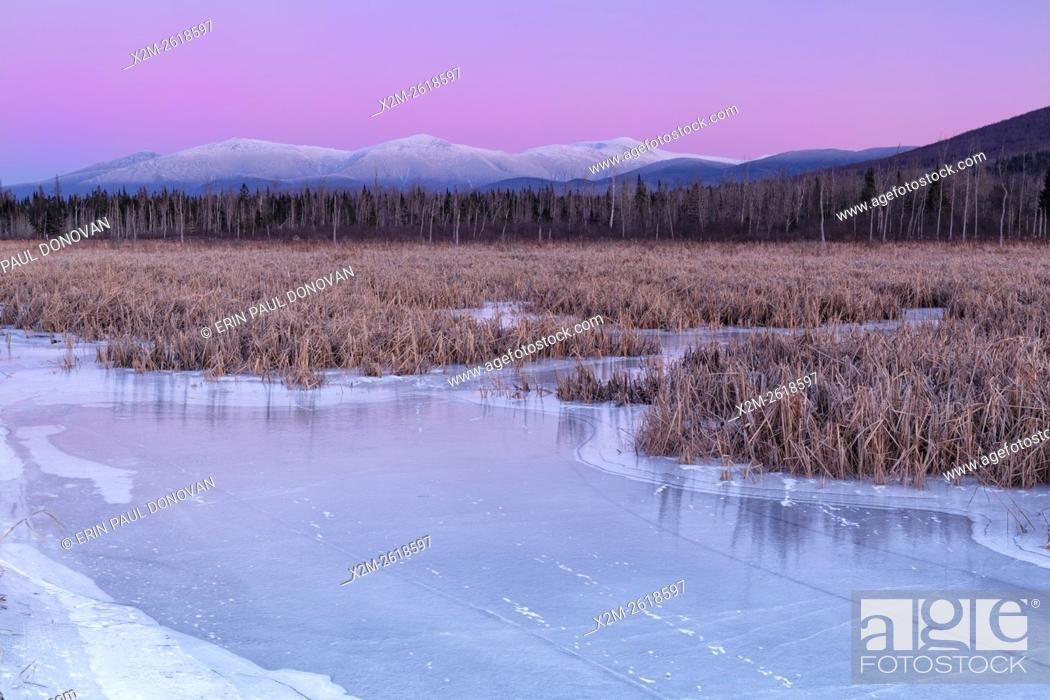 Stock Photo: Snowcapped Presidential Range at sunset from the Presidential Range Rail Trail (Cohos Trail) at Pondicherry Wildlife Refuge in Jefferson, New Hampshire USA.