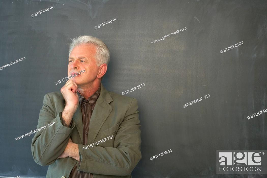 Stock Photo: Professor in front of a blackboard.