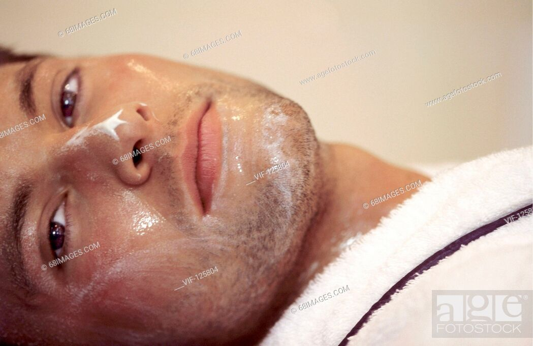 Stock Photo: Wellness - Muk Abhyanga - young man relaxing after a facial massage. - HAMBURG, GERMANY, 20/09/2005.