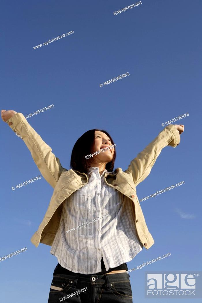 Stock Photo: View of a happy young woman.