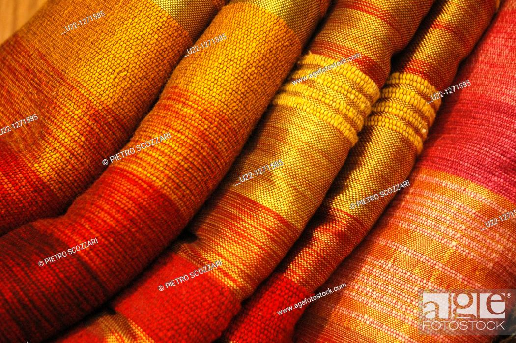 Stock Photo: Fez (Morocco): fabrics sold in a handicrafts shop in the medina.