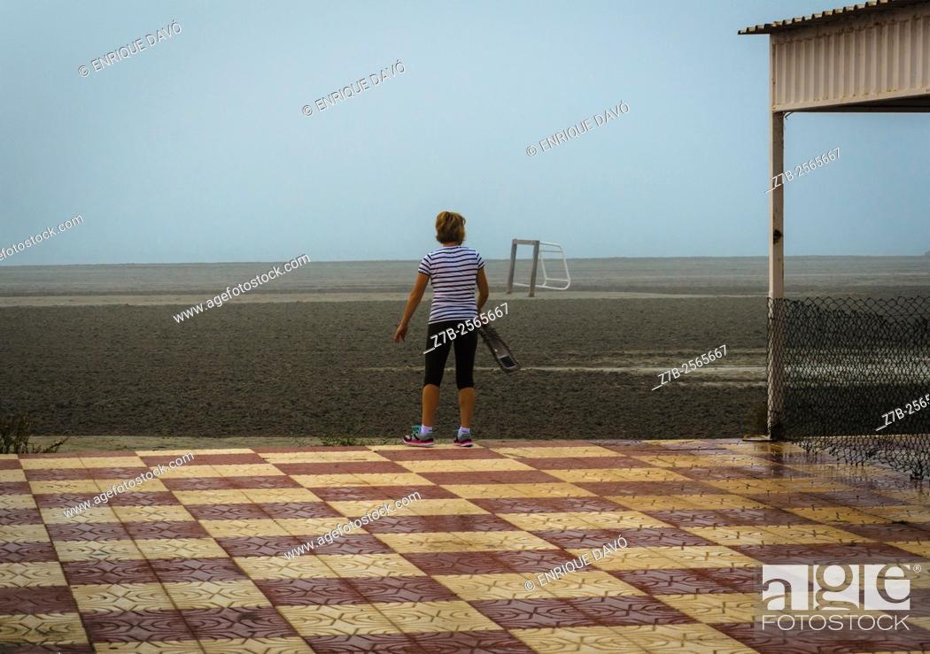Stock Photo: A woman back view in Playa Lisa beach, Alicante, Spain.
