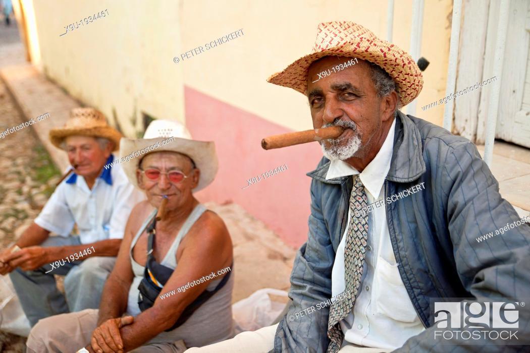 835367fc1 elderly man smoking cigars, Trinidad, Cuba, Caribbean, Stock Photo ...