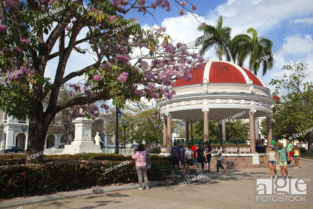Stock Photo: Tourists in front of the Pavilion at Parque Jose Marti in Plaza de Armas Square at the historic center, Cienfuegos, Cuba, West Indies, Central America.