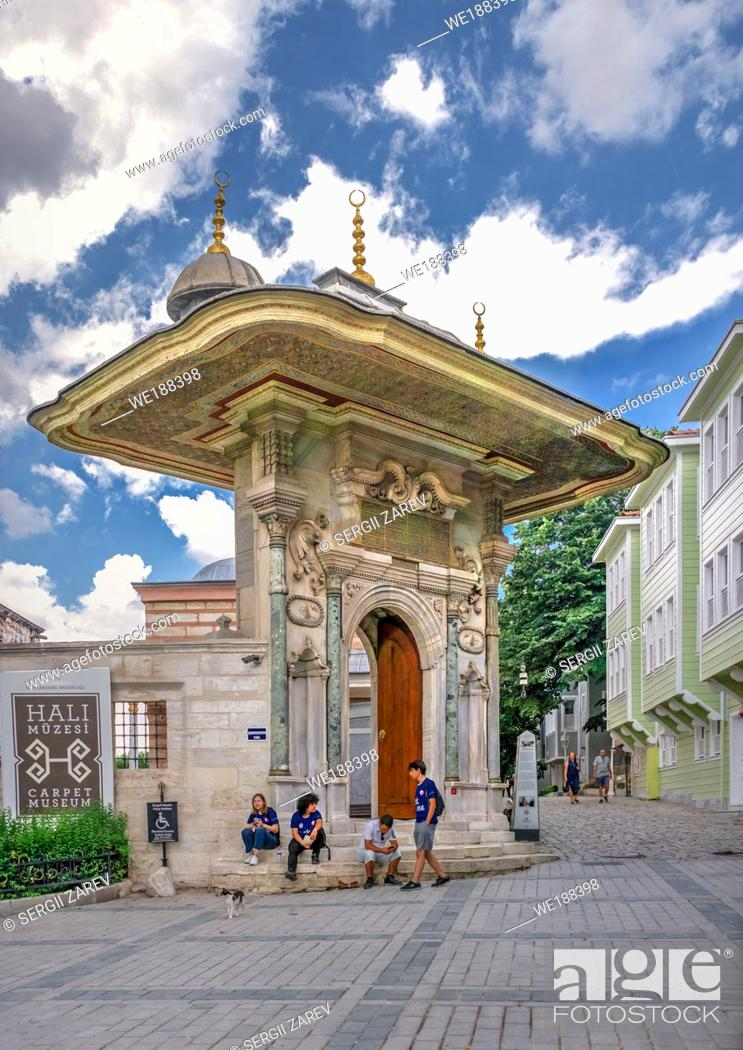 """Stock Photo: Istambul, Turkey â. """" 07. 12. 2019. Carpet Museum near the Entrance gate to the Topkapi Palace in Istanbul, Turkey, on a cloudy summer day."""
