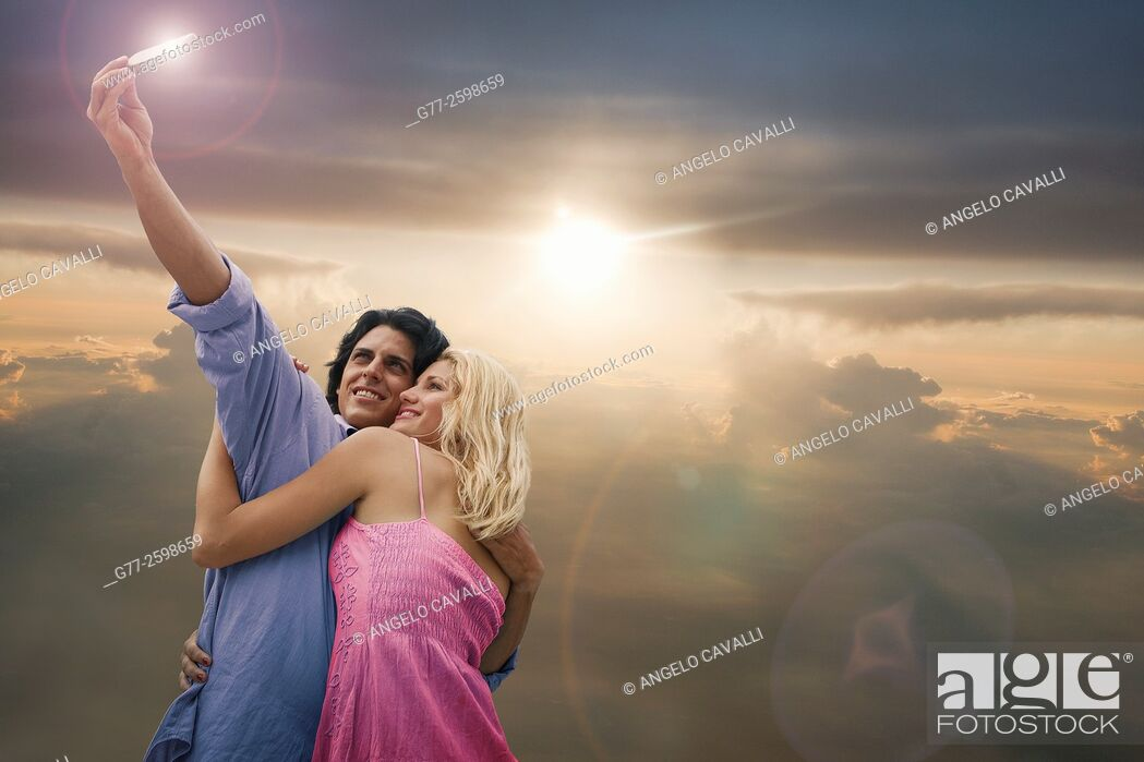 Stock Photo: Miami Beach. Florida. Usa. Couple taking selfie.