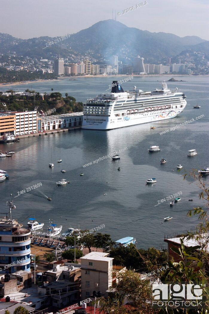 Stock Photo: Mexico, Acapulco, Luxury Cruise in bay with city and mountain in background.