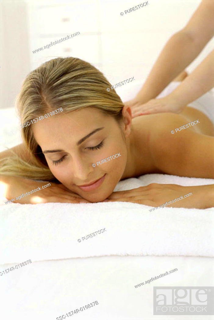 Stock Photo: Young woman getting a back massage.