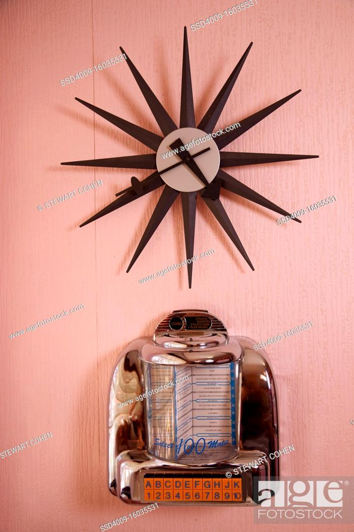 Stock Photo: Vintage clock on a pink wall.