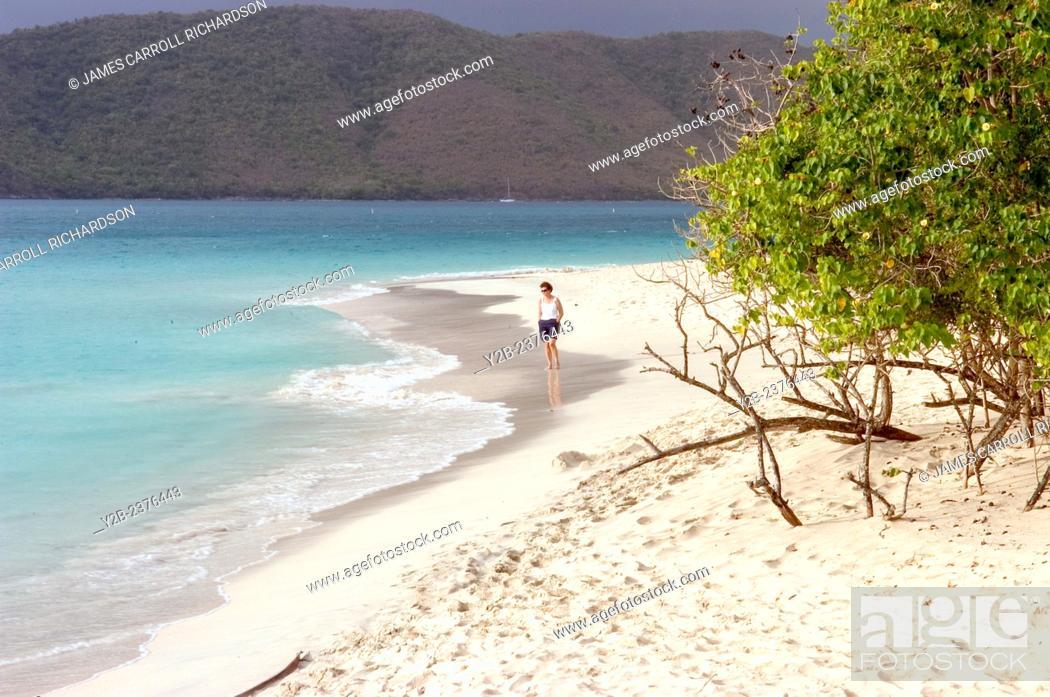 Stock Photo: Cinnamon Bay beach scenes St John US Virgin Islands and beach comber.
