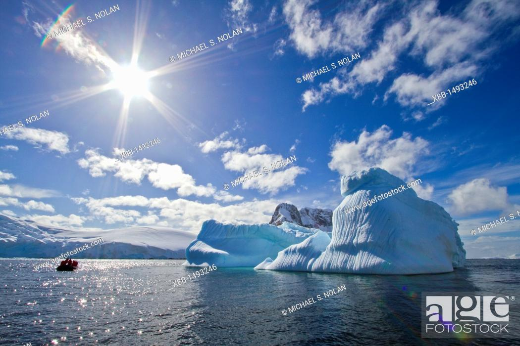 Stock Photo: Iceberg in Lemaire Channel on the western side of the Antarctic Peninsula during the summer months, Southern Ocean  MORE INFO An increasing number of icebergs.
