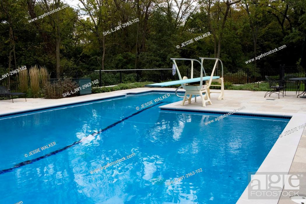 Swimming Pools Fenced Pool Area With Black Patio Furniture Diving