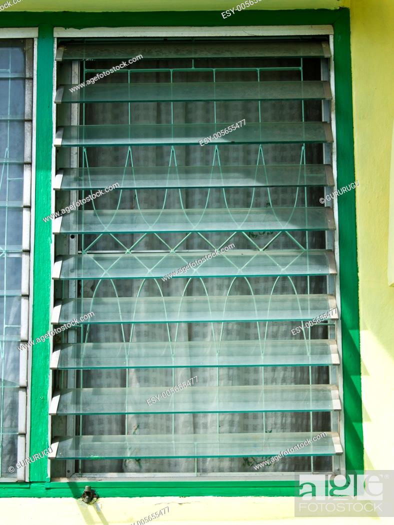 Stock Photo: An opened glass louver window.