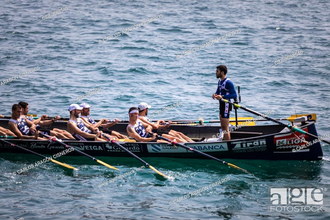 Stock Photo: CASTRO URDIALES, SPAIN - JULY 15, 2018: Competition of boats, regata of trainera, Tiran Pereira boat in action in the VI Bandera CaixaBank competition.