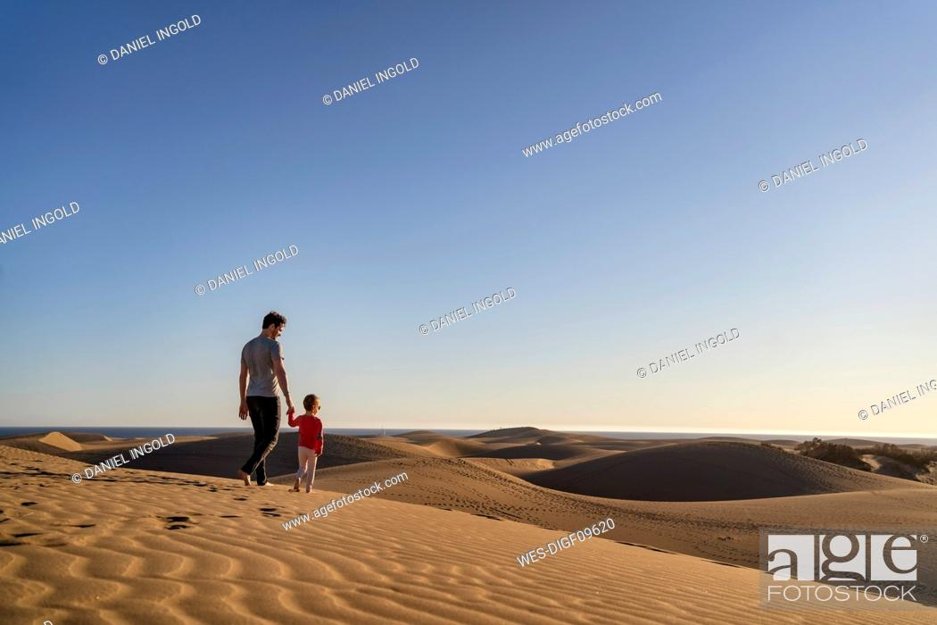 Stock Photo: Father and daughter in sand dunes, Gran Canaria, Spain.
