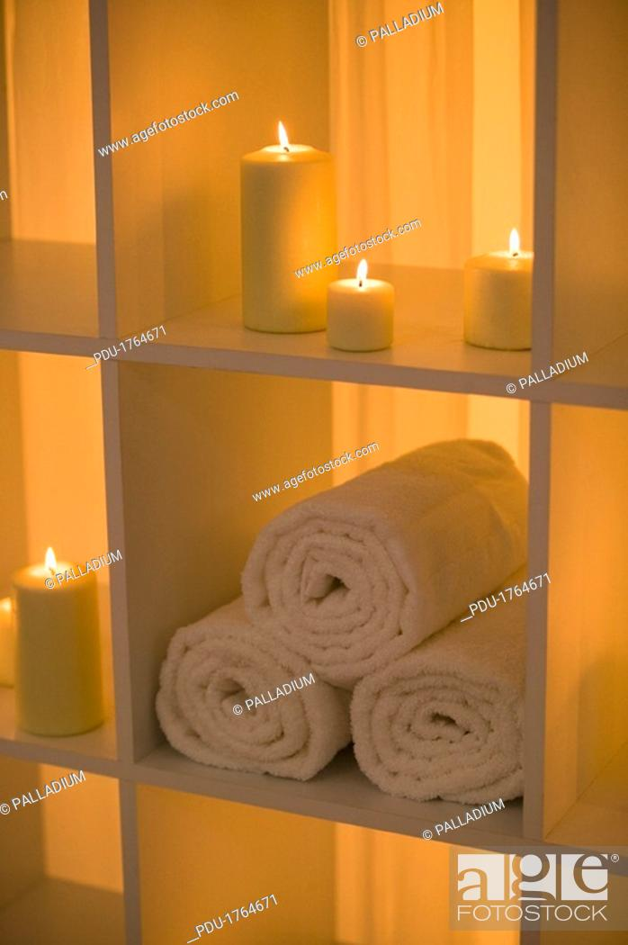 Stock Photo: Candles and towels.