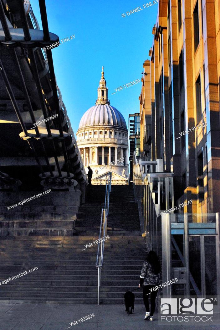 Stock Photo: View of St. Paul's Cathedral from the banks of the River Thames by the Millenium Bridge (seen on the left-hand side) including street vendor on Peter's Hill and.