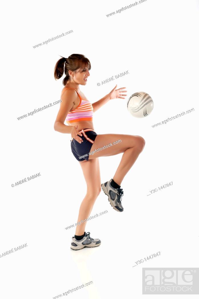 Stock Photo: Hispanic woman juggling soccer ball.