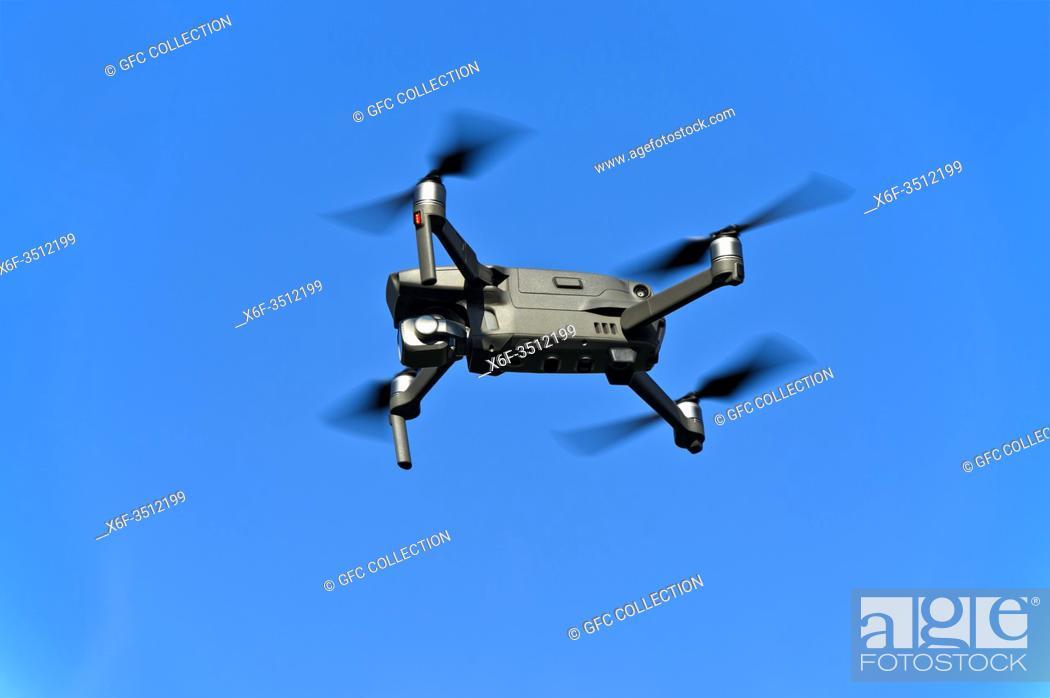 Photo de stock: Drone in flight against the blue sky.