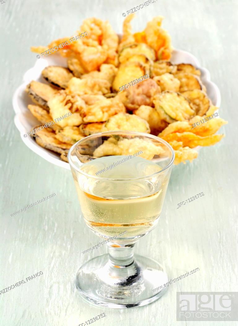 Stock Photo: Fritto misto with vegetables and a glass of white wine.