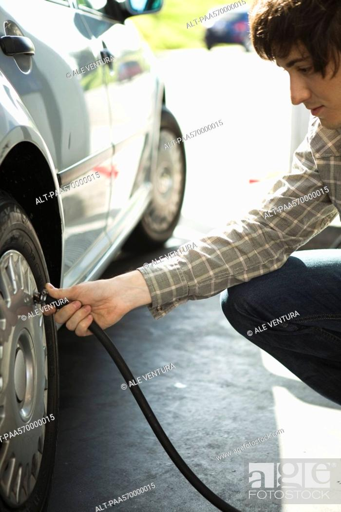Stock Photo: Inflating car tire.